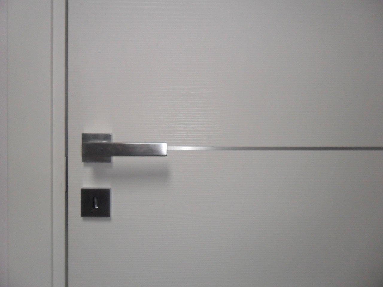 Porta interna battente bianca lesizza serramenti for Porta interna bianca con vetro
